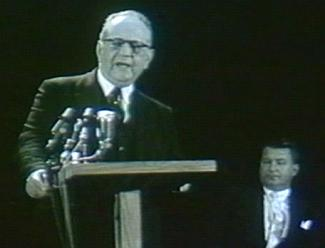 man at podium